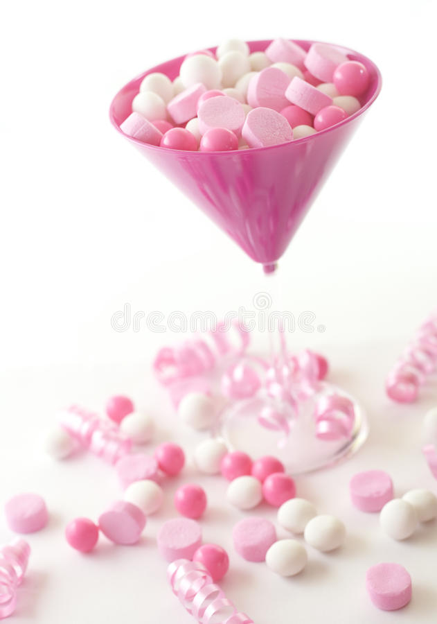 Candies in a martini glass stock photo