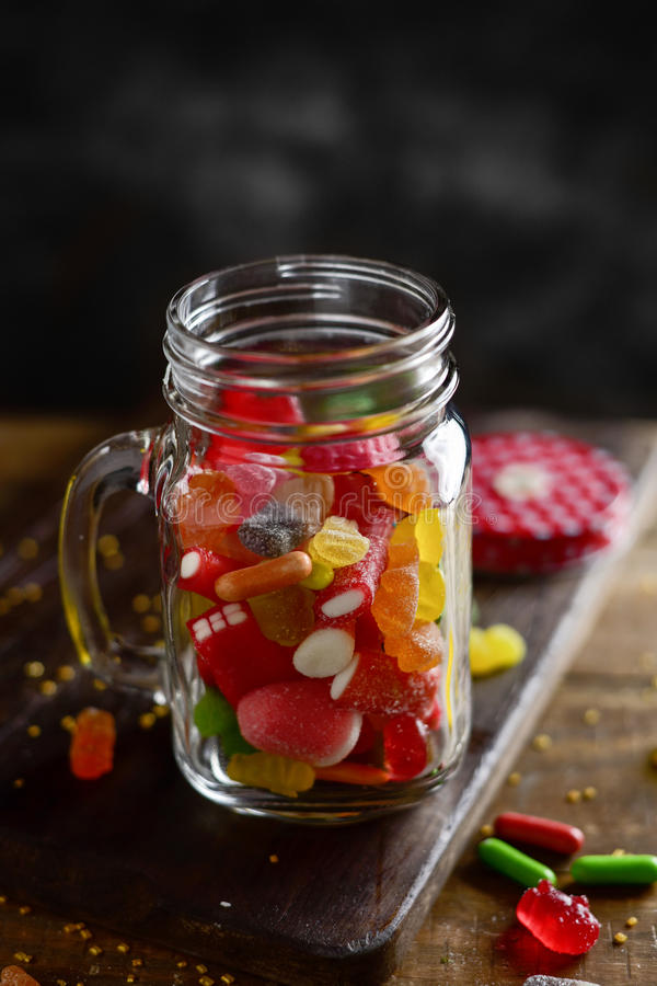 Candies in a mason jar royalty free stock images
