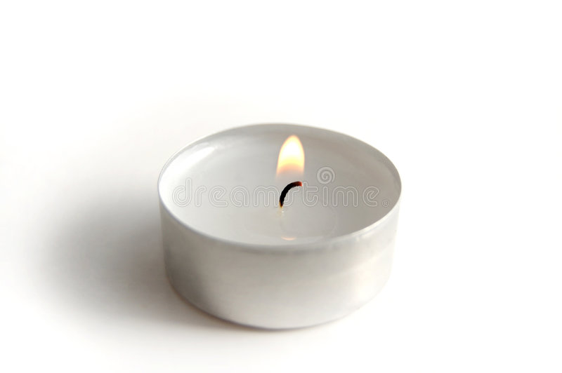 Candle. Small white candle on a white background stock images