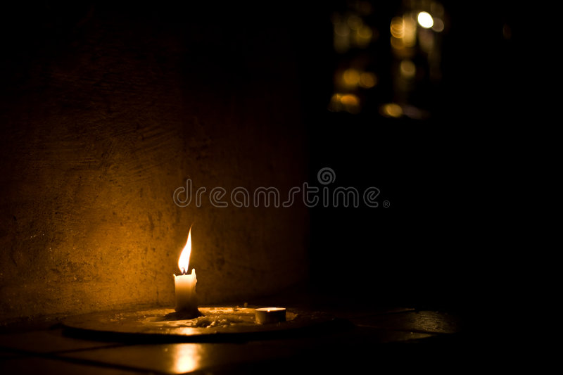 Candle. A candle in a shaded environment stock photos
