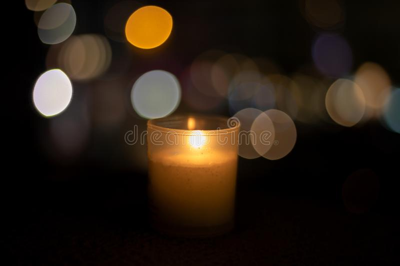 Candle alone with a great bokeh stock photo