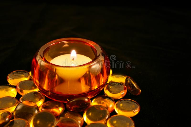 Candle in Amber Holder with Beads stock photos