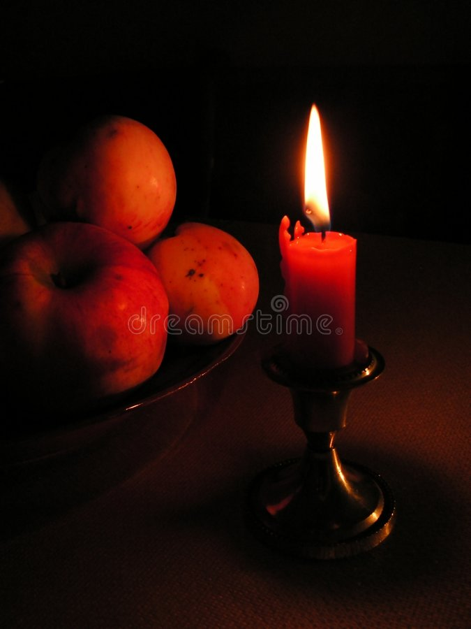 Candle and apples stock images