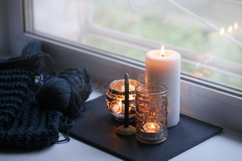Candle and aroma stick on windowsill. Concept of relax, tranquil, peaceful, unplug, balanced time, Keep kalm and take it easy,. Candle and aroma stick on stock photography