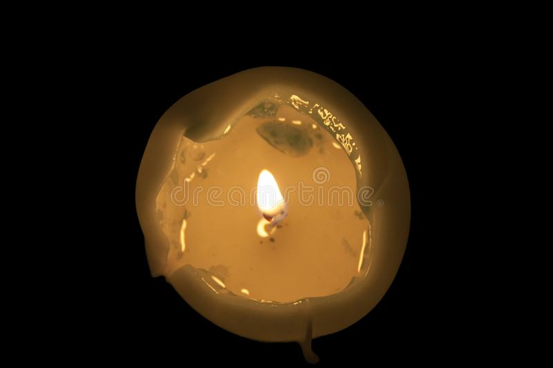 Candle in a big glass jar. Candle in a big green glass jar jar not visible, but collours the candle royalty free stock photo