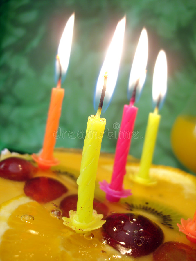 Candle with birthday cake. Close-up of candle with birthday cake royalty free stock photo