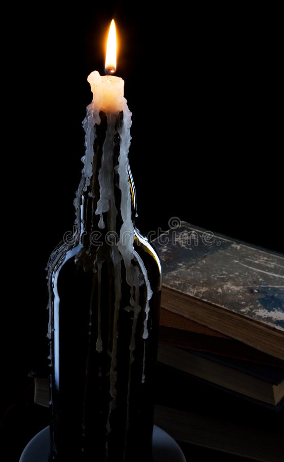 A candle in a bottle royalty free stock images