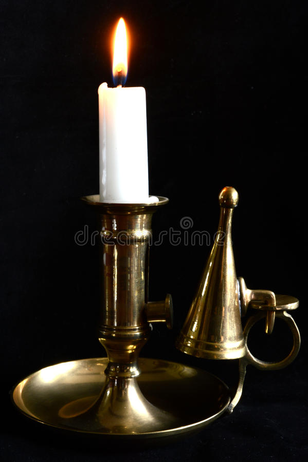 Candle in candle holder. A candle in a brass candle holder royalty free stock photos