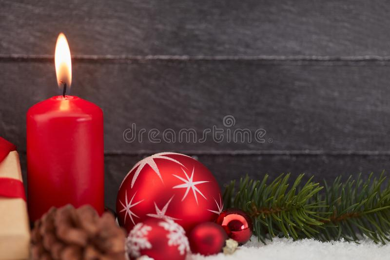 Candle for christmas or advent. Red burning candle for christmas or advent royalty free stock image