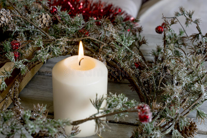 Candle and Christmas wreath royalty free stock images
