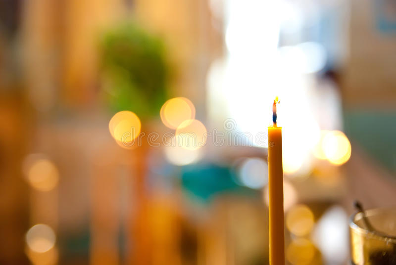 Candle in a church stock photo