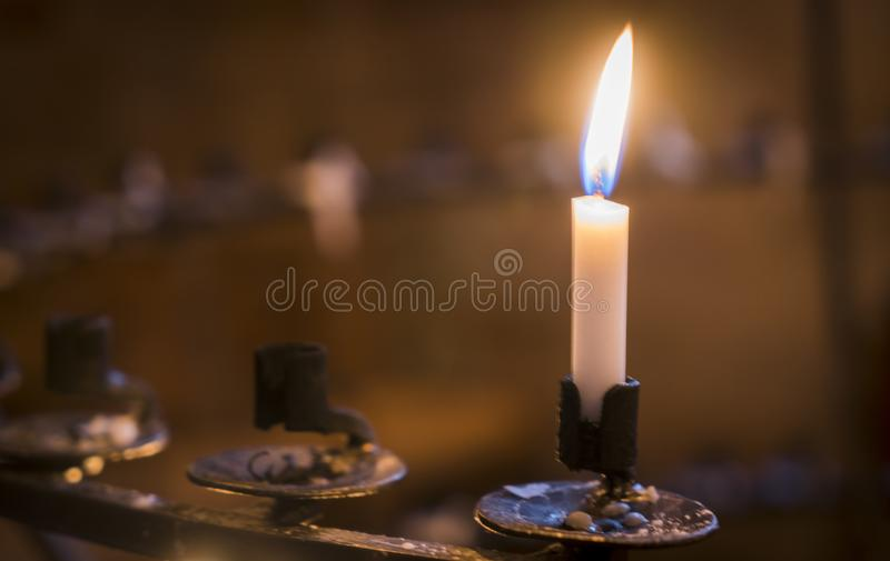 Candle in the church, praying with faith, traditional visit of a holy place for Easter, great Christian holiday, belief in God royalty free stock image