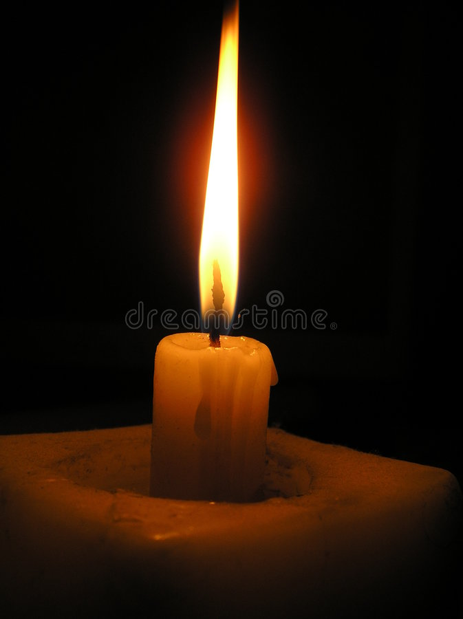 Candle in dark royalty free stock photo
