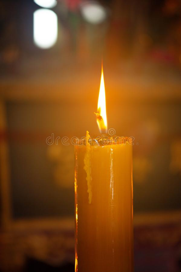 A candle on dark blur background royalty free stock images