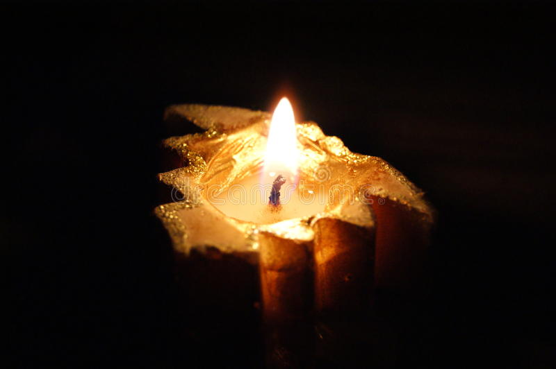 Candle in the dark royalty free stock photos