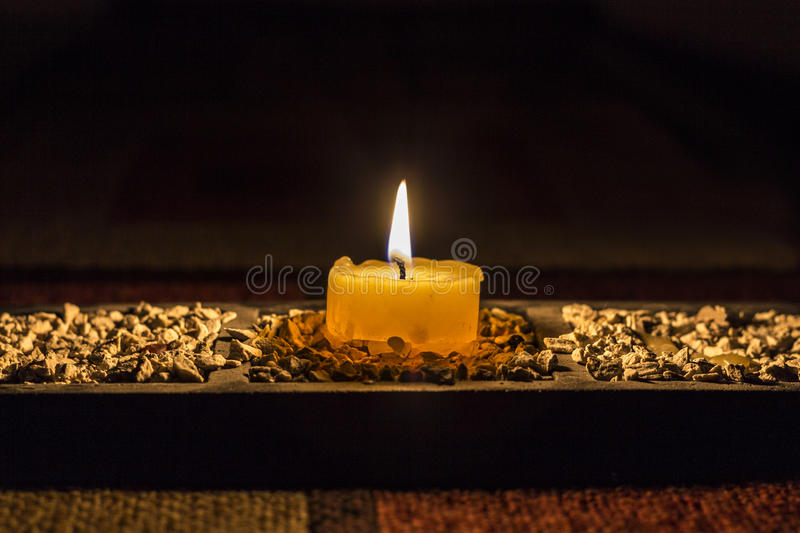 Candle in dark room royalty free stock photos