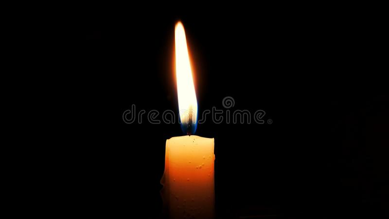 Candle in dark room royalty free stock photo