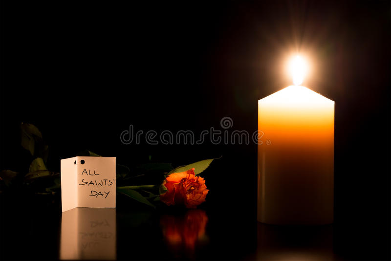 Candle in the darkness during All Saints Day stock photography