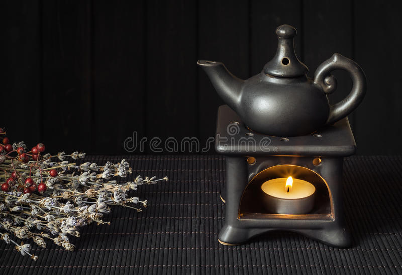 Candle driven aroma lamp diffuse essential oils royalty free stock image