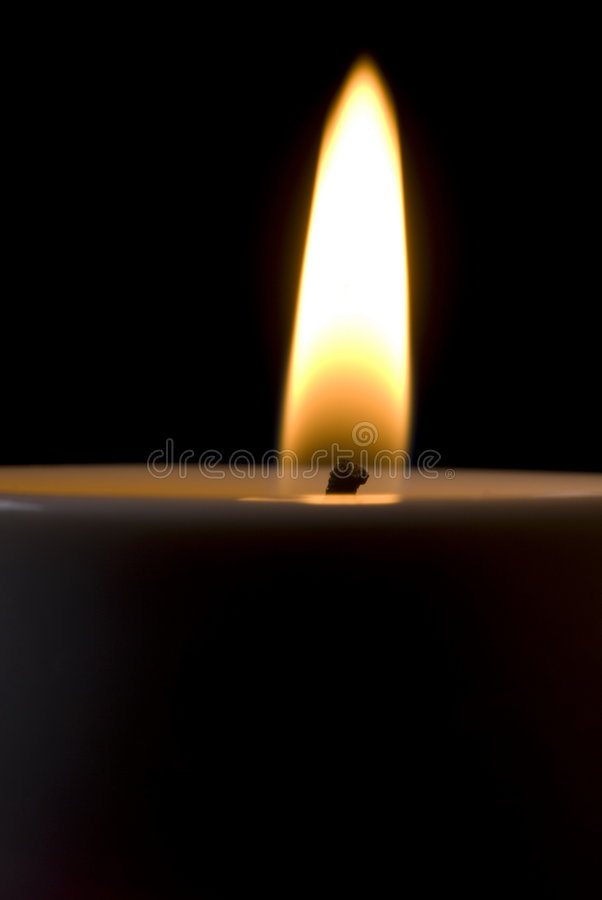 Candle - extremely closeup. Fire burning in Candle - extremely closeup stock photos