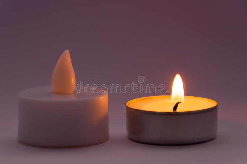 Candle Fake VS Real Concept royalty free stock photos