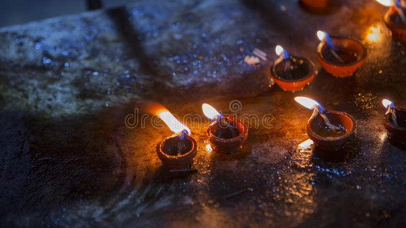 Candle flame close-up in the Indian Temple on a Religious Festival Diwali. Oil Lamp. In Beautiful candlestick. Spiritual, Mystical and Religious Traditions of royalty free stock image
