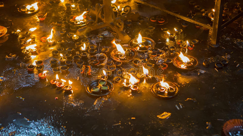 Candle flame close-up in the Indian Temple on a Religious Festival Diwali. Oil Lamp royalty free stock images