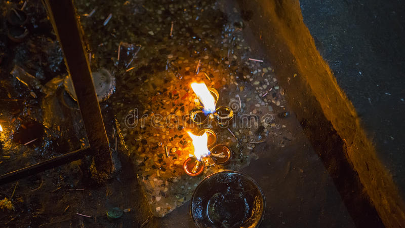 Candle flame close-up in the Indian Temple on a Religious Festival Diwali. Oil Lamp stock image