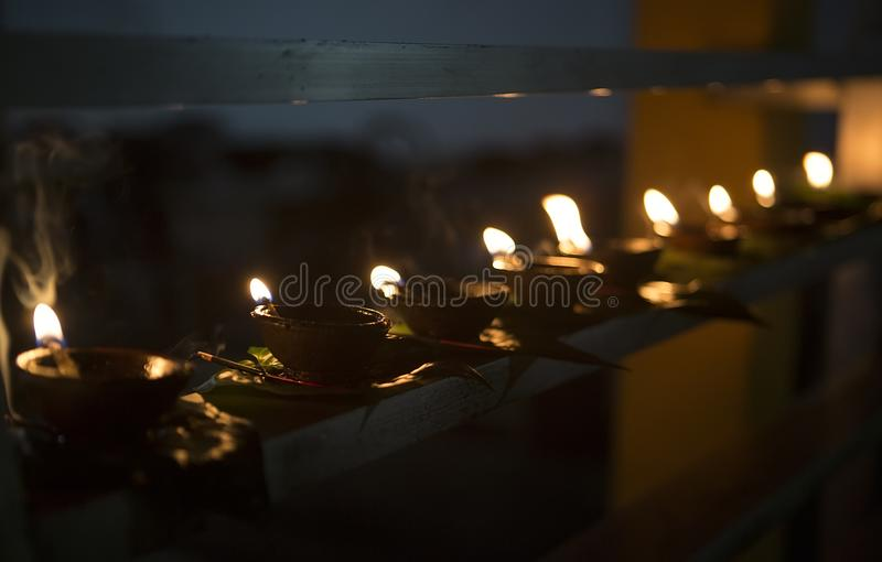 Candle flame close-up. Many Candles in a Buddhist temple. Religious Festival. Oil Lamp stock photos