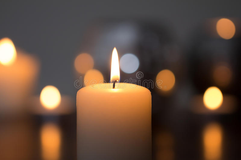 Candle flame closeup. Candle flame in dark closeup royalty free stock images