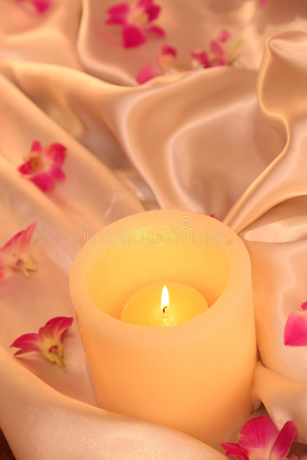 Candle and flowers royalty free stock image