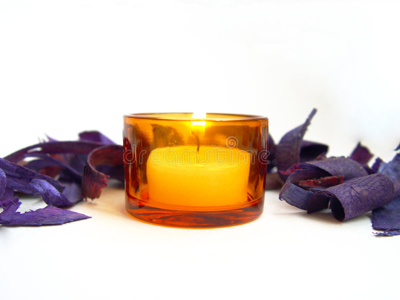 Candle with flowers around stock images