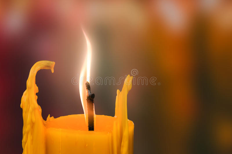 Candle in front of many defocused candleflames creating a spirit stock photos