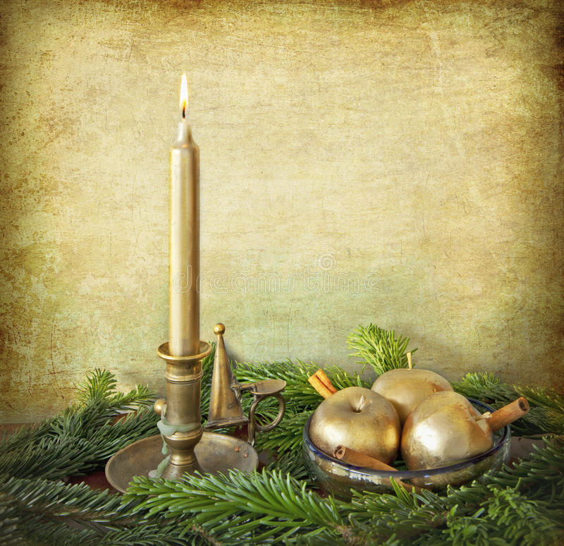 Candle, golden apples, cinnamon and fir branches stock photo