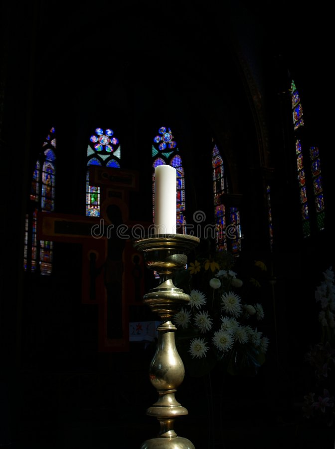 Candle in Gothic Church stock images