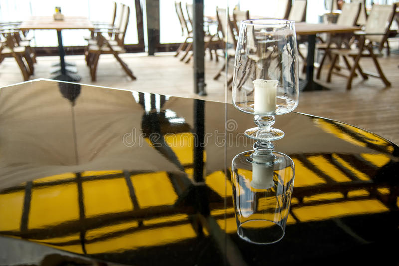 Candle on a grand piano in a restaurant royalty free stock photography