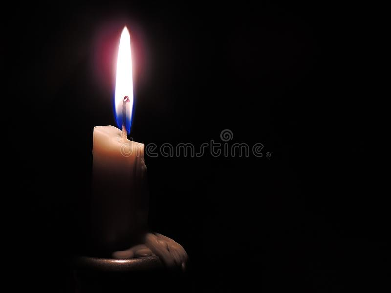 Candle in half light royalty free stock images