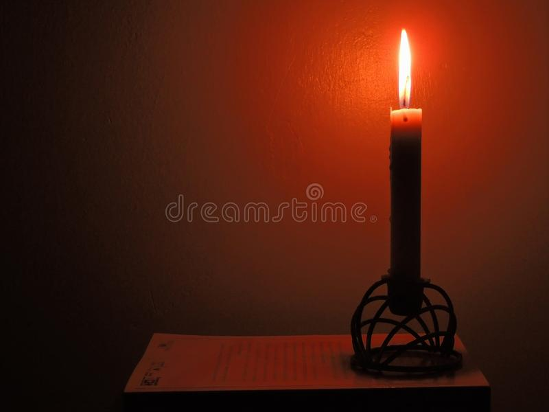 Candle in half light royalty free stock photography