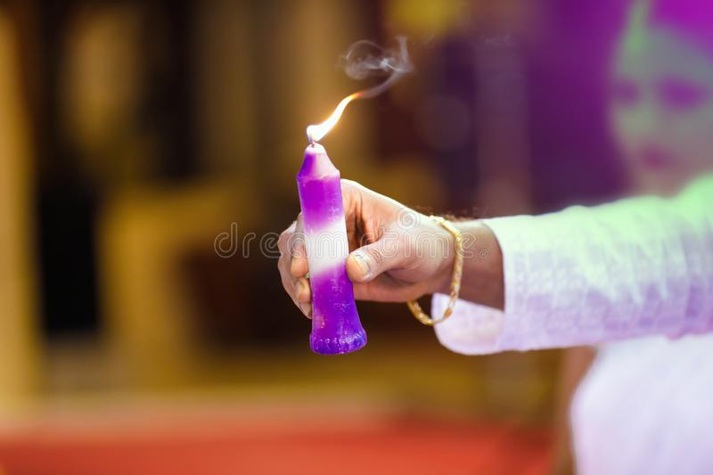 Candle in hand royalty free stock image