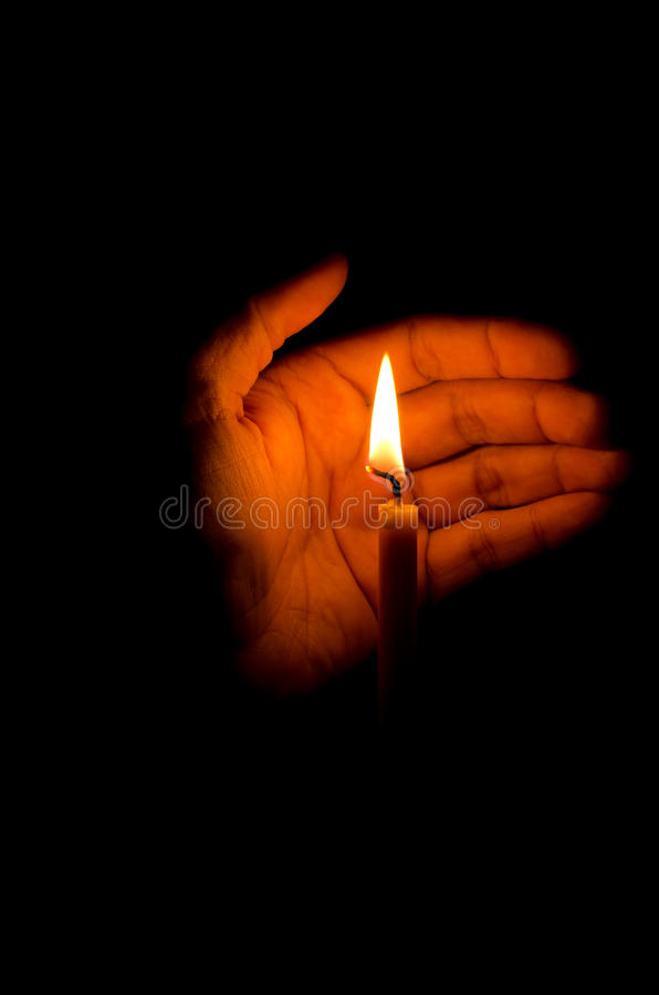 Download The candle in hand protect stock photo. Image of yellow - 21655338