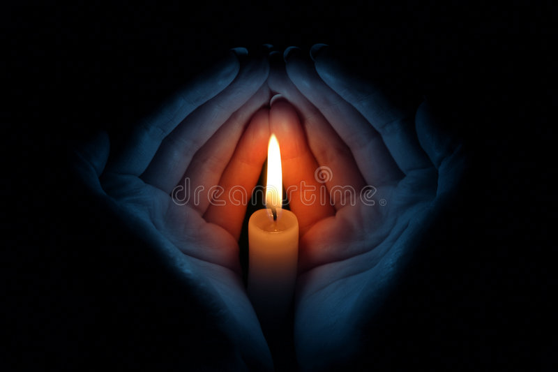 Candle in hands royalty free stock image