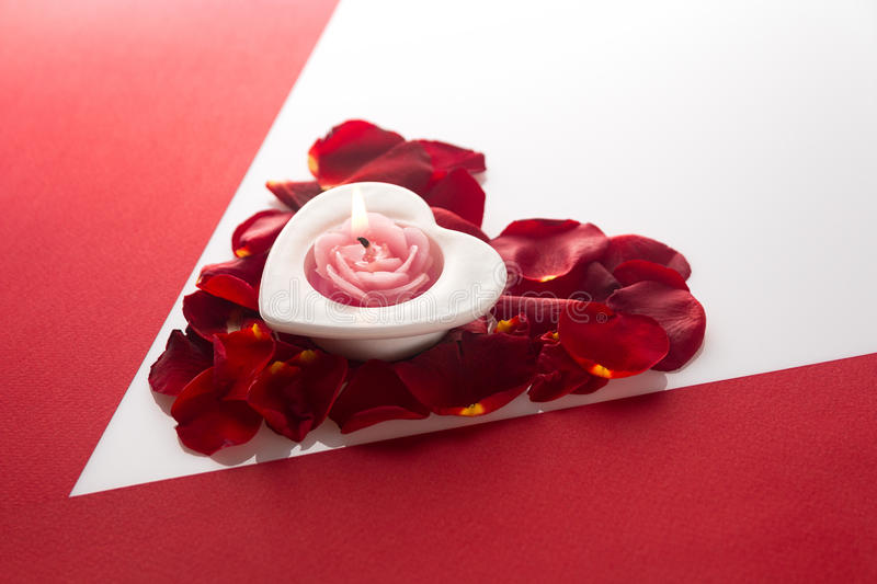 Download Candle Heart On The Heart Of Rose Petals Corner Red White Backgr Stock Photo - Image: 83716523