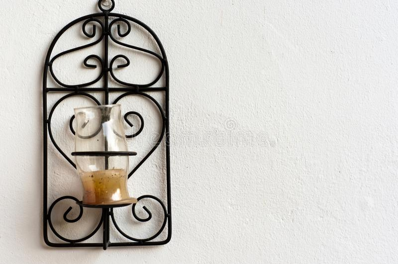 Candle holder. Made out of steel on white background stock image