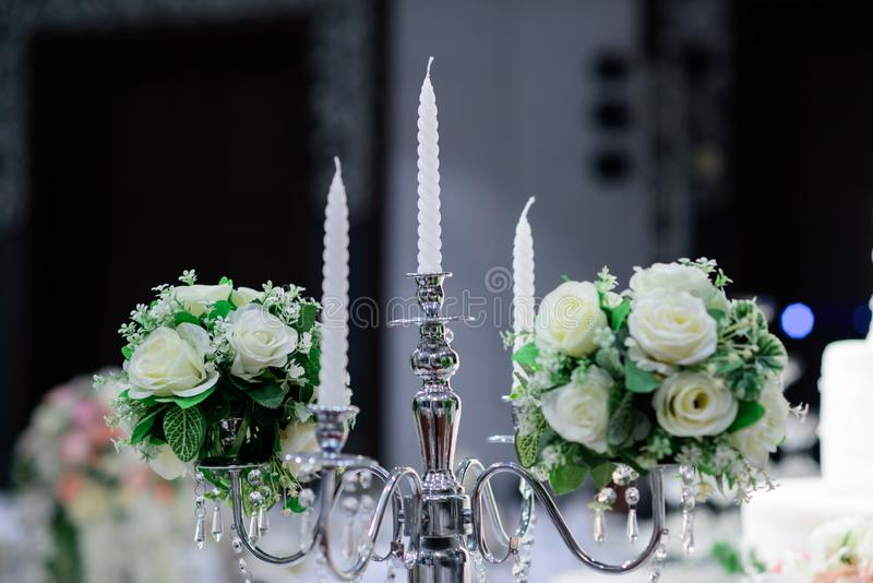 Candle holder with candle. Decorated with beautiful rose Prepared for wedding stock images