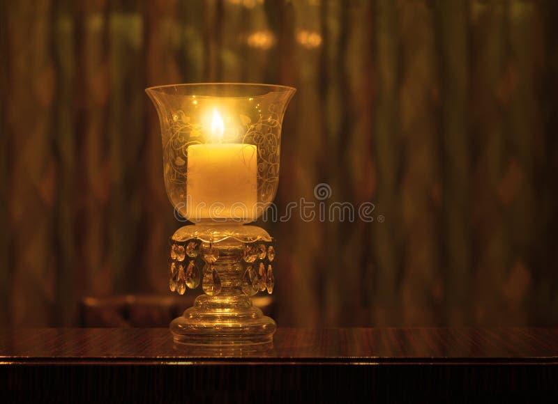 Candle holder. An illuminated decorative candle holder royalty free stock photos