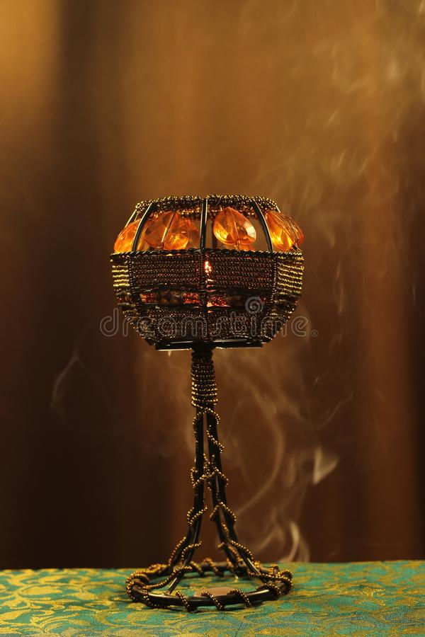 Candle holder in smoke stock photos