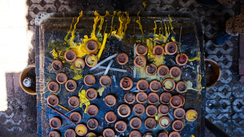 Download Candle Holders And Yellow Wax On A Buddha Shrine Stock Image - Image of holders, ceramic: 82032707