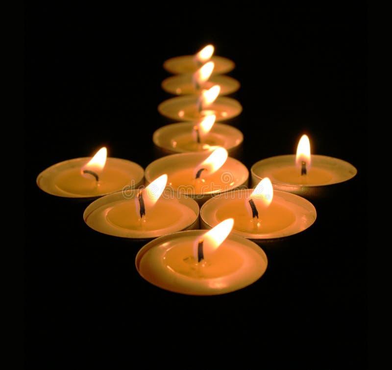 Candle light arrow stock photo