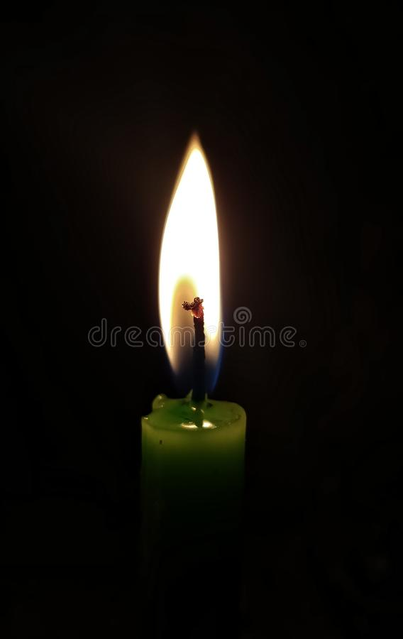 Candle light with black background stock image