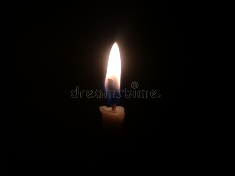 Candle Light with the black background stock photos